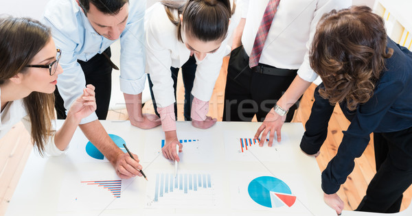Financial consultants in bank analyzing data Stock photo © Kzenon