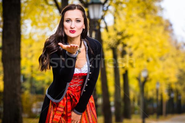 Girl in Dirndl blows a kiss Stock photo © Kzenon