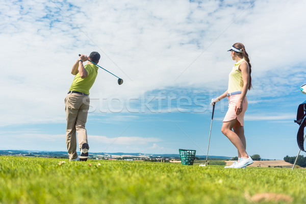 Young woman practicing the correct move during golf class with a Stock photo © Kzenon