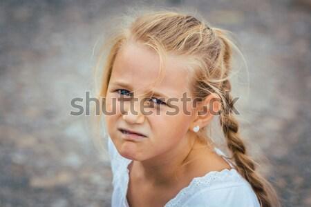 Grincheux fille regarder caméra petite fille heureux Photo stock © Kzenon