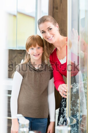 Happy couple choosing a new faucet in a modern sanitary ware shop Stock photo © Kzenon