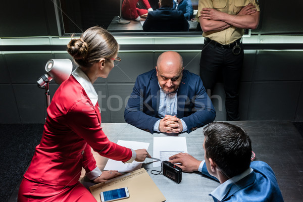 Stock photo: Middle-aged man thinking about his statement and the criminal charge