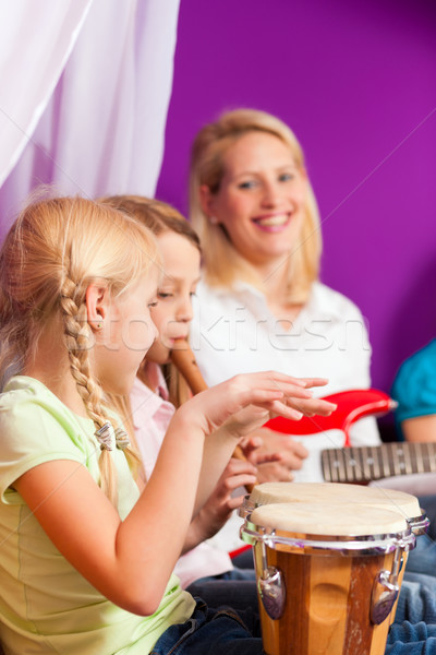 Stock photo: Family making music at home