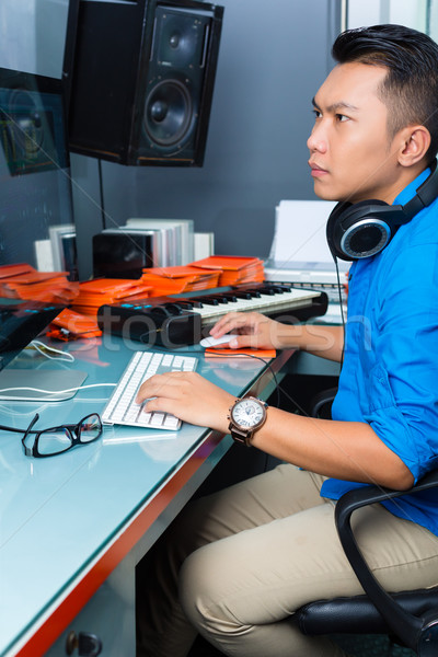 Indonesian man in recording studio Stock photo © Kzenon