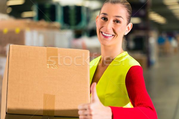 worker holds package in warehouse of forwarding Stock photo © Kzenon