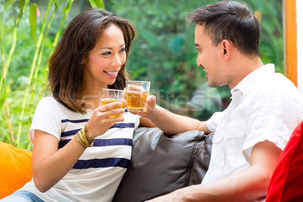 Asian couple on the sofa Stock photo © Kzenon