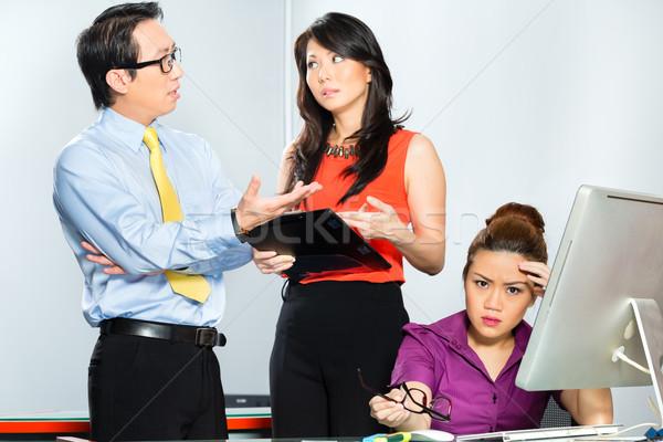 Asian colleagues mobbing or bullying employee  Stock photo © Kzenon