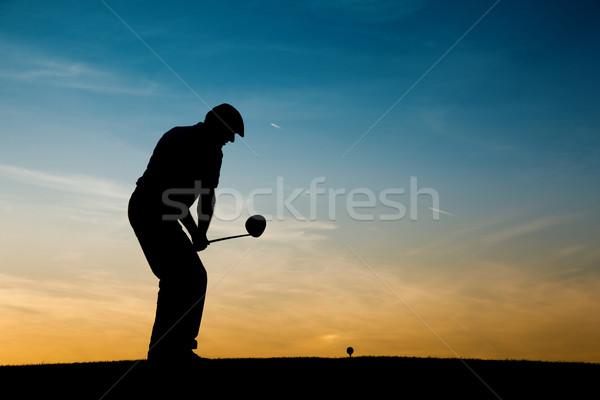 Senior male golf player at sunset Stock photo © Kzenon