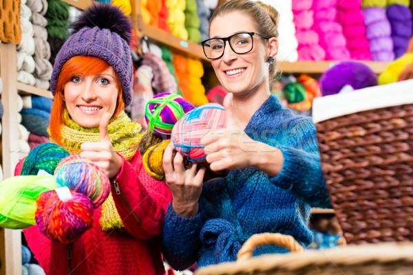 Young women in knitting fashion shop Stock photo © Kzenon