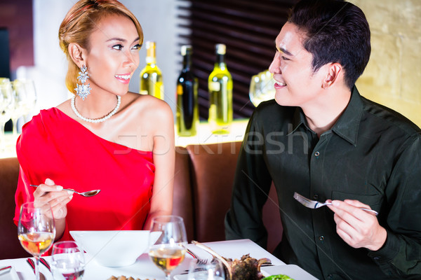 Asian couple fine dining in fancy restaurant Stock photo © Kzenon