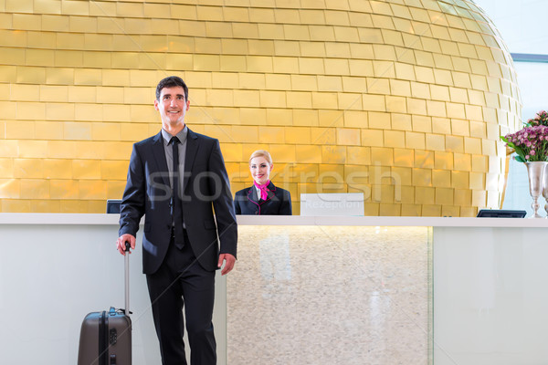 Man departing on business trip at hotel reception  Stock fotó © Kzenon