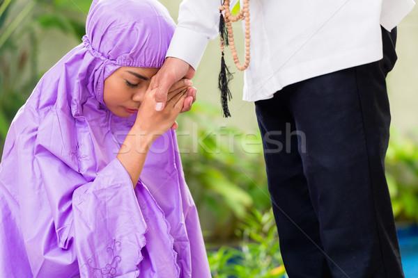 Asian Muslim couple, man and woman, praying at home Stock photo © Kzenon