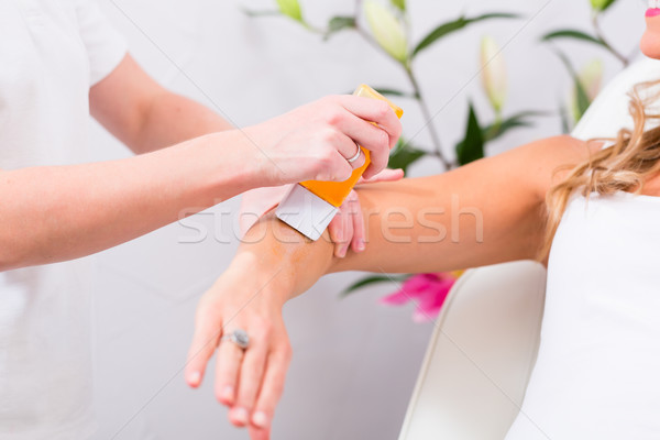 Woman at waxing hair removal in beauty parlor Stock photo © Kzenon