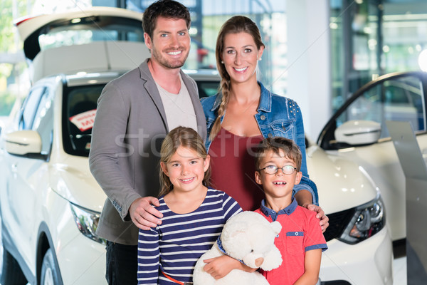 Family with children buying new car at auto dealership  Stock photo © Kzenon