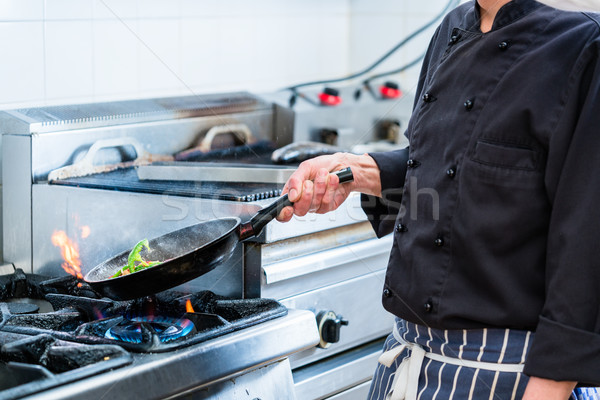Chef roasting vegetables in restaurant kitchen Stock photo © Kzenon