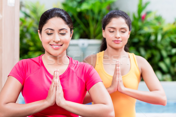 Two women in lotus position during yoga practice Stock photo © Kzenon