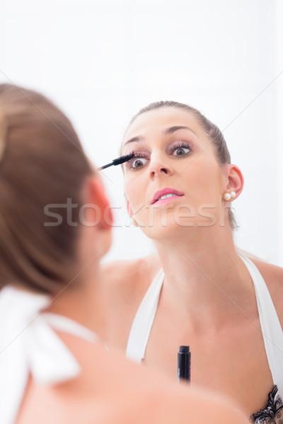 Nő smink szempilla fürdőszoba tükör szem Stock fotó © Kzenon