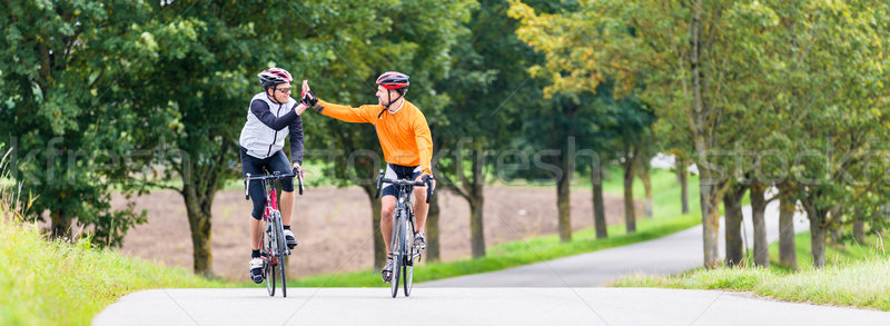 Course cyclistes sport high five fitness entraînement Photo stock © Kzenon