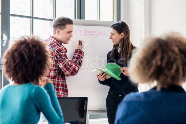Students sharing ideas and opinions while brainstorming during a Stock photo © Kzenon