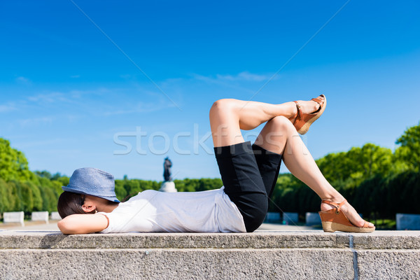 Relaxed tourist lying down in the park Stock photo © Kzenon