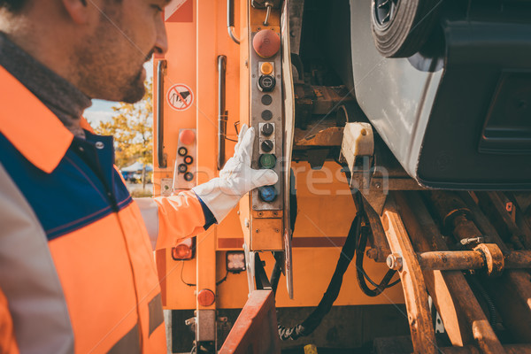 Worker emptying dustbin into waste vehicle Stock photo © Kzenon