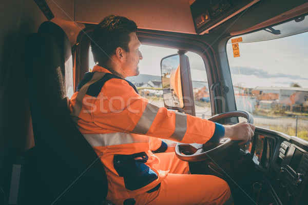 Garbage removal worker driving a dump truck  Stock photo © Kzenon