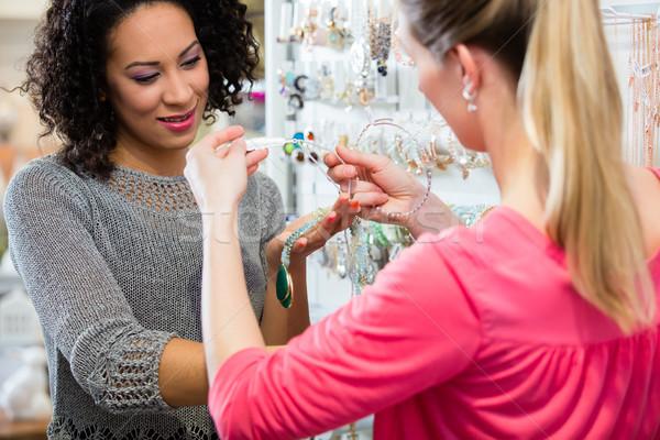 Two friends choosing jewellery in fashion store Stock photo © Kzenon