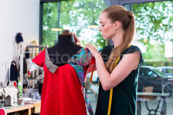 Fashion designer draping dress on mannequin Stock photo © Kzenon