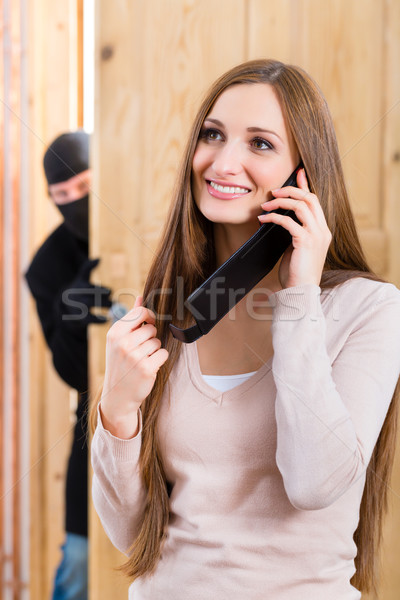 Burglary crime - culprit and victim Stock photo © Kzenon