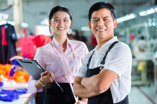 Production manager and designer in Asian factory Stock photo © Kzenon