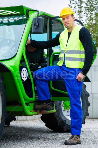 Constructeur construction machines pilote permanent Photo stock © Kzenon