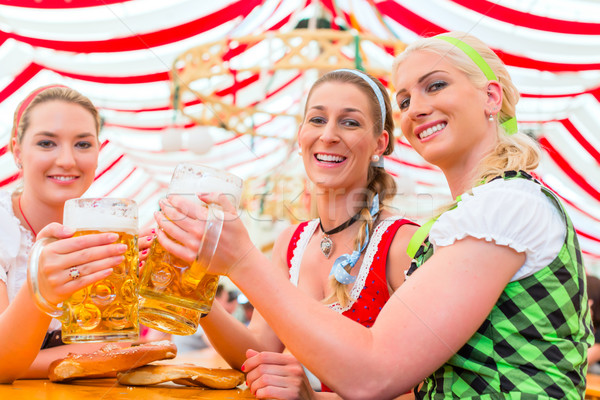 Friends drinking Bavarian beer at Oktoberfest Stock photo © Kzenon