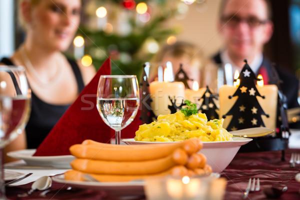 German Christmas dinner sausages and potato salad Stock photo © Kzenon