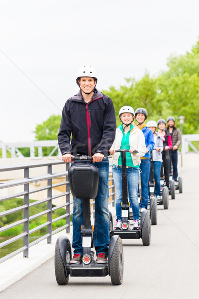 Tourist group driving Segway at sightseeing tour Stock photo © Kzenon