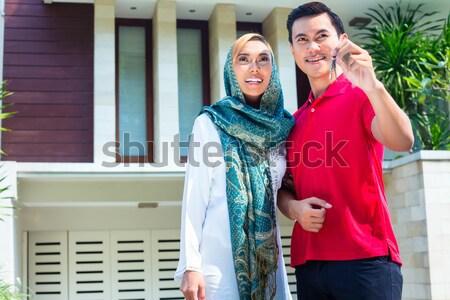 Asian Muslim couple moving into house Stock photo © Kzenon