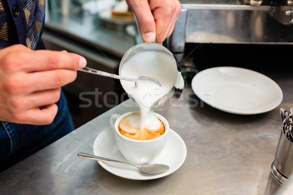 Barista kávézó kávézó cappucchino áramló tej Stock fotó © Kzenon