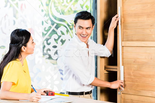 Asian couple buying cabinet in furniture store Stock photo © Kzenon