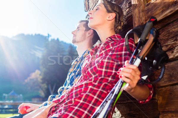 Couple resting from nordic walking in mountain cabin Stock photo © Kzenon