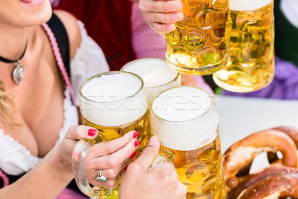 Clinking glasses with beer in Bavarian pub Stock photo © Kzenon