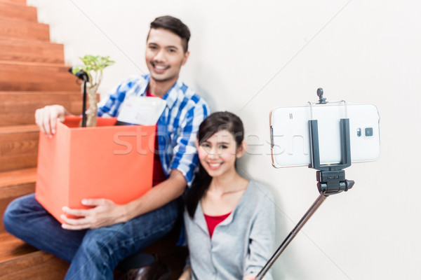 Asian couple taking selfie from their moving day Stock photo © Kzenon
