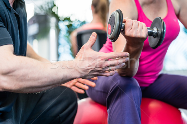 senior woman working out with dumbbells with personal trainer Stock photo © Kzenon