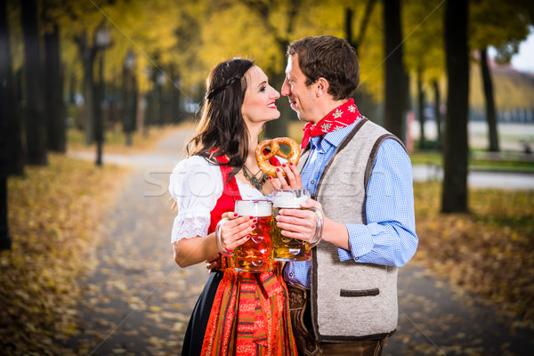 Man and Woman in a hug with Beer and Pretzel Stock photo © Kzenon