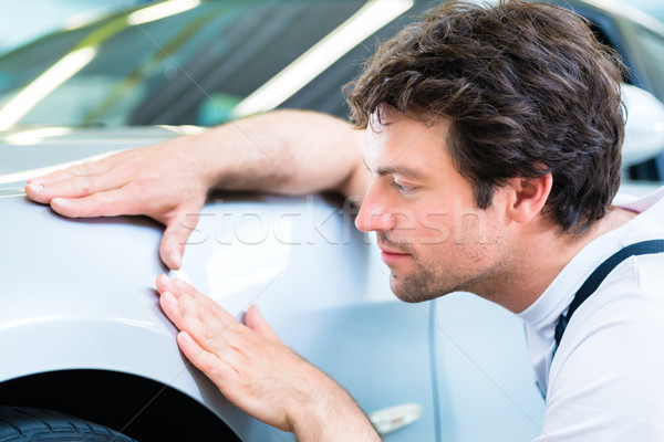 Mechanic controlling lacquer in car workshop Stock photo © Kzenon