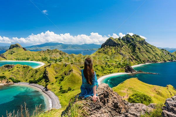 Young woman enjoying the awesome view of Padar Island during sum Stock photo © Kzenon