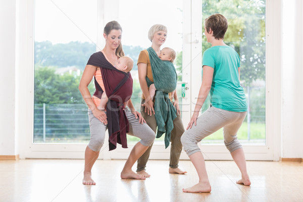Young women wearing babies for mother-child bonding and doing pe Stock photo © Kzenon