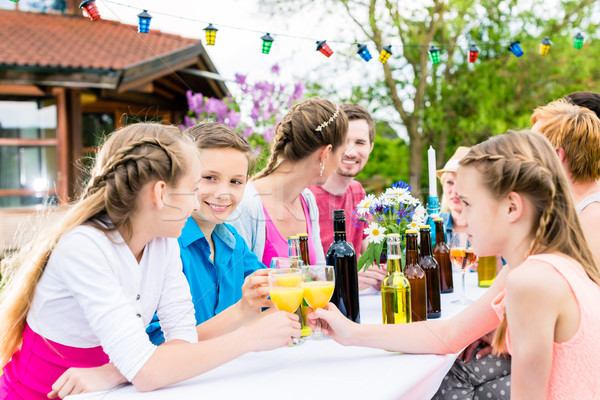 Garden party for family and neighbors  Stock photo © Kzenon