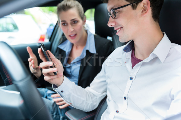 Driving instructor with student in car Stock photo © Kzenon