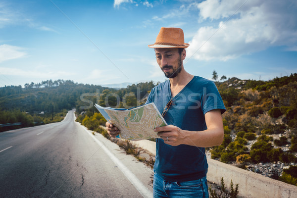 Tourist man reading the map being lost on a trip Stock photo © Kzenon