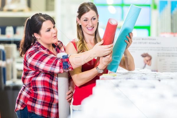 Women in home improvement store choosing wallpapers Stock photo © Kzenon