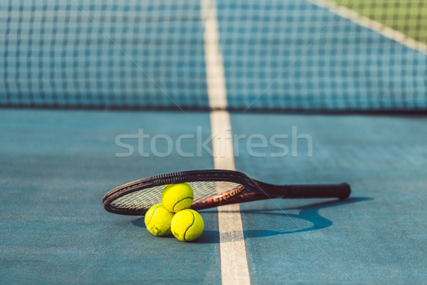 High-angle close-up of three tennis balls on a professional rack Stock photo © Kzenon